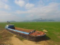 Huge cargo ship became stranded on the lake bed in Lushan District of Jiujiang after the water vanished