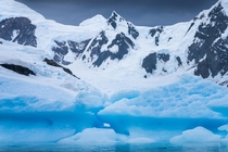 Huge ice pieces and rugged peaks in Antarctica x