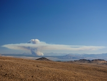 Huge smokestack pyrocumulus cloud over Mono Lake from a forest fire in Yosemite