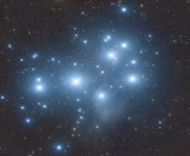 Hundreds of Galaxies in the Pleiades