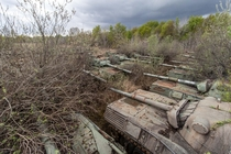Hundreds of old tanks rotting in a field