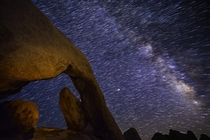 I captured Earths rotation over  hour in Joshua Tree National Park Check out Mars in the center