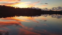 I caught this on my way home from work one day I stood there in awe The lake was like glass So smooth and beautiful