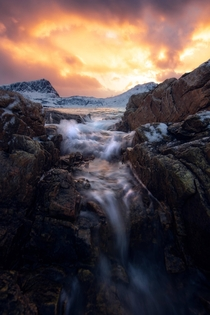 I did indeed get wet for this photo Coastal sunset on the Lofoten Islands Norway