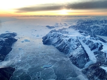 I flew over Greenland for the first time with no cloud cover Such a cool experience I felt like I was on another planet