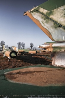 I found dozens of abandoned MiG- Jet Planes parked on a field