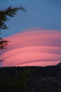 I had  seconds to find my camera and capture this lenticular cloud at sunset in the Sierra Nevada Spain