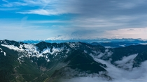 I hiked Mailbox Peak in Washington on a sunny and a cloudy day and merged two pictures of Mount Rainier
