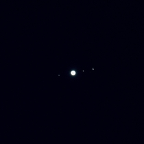 I pointed my telephoto lens at Jupiter out my apartment window and I could see its moons