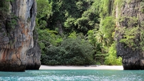 I snapped this in Ao Phang Nga National Park Thailand a few years ago It has been my wallpaper ever since