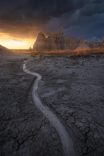 I stuck around for this thunderstorm to pass through the Badlands and it sure paid off insane light at sunset Badlands National Park South Dakota  mattymeis