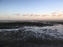 I thought the evening reflection of the water puddles left at low tide looked cool Leadbetter Point SP WA