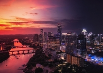 I took eleven photos of my citys skyline from sunset to night and merged them