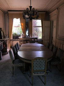 I visited an abandoned mansion earlier this summer its still almost fully furnished The dining hall alone is amazing The walls are decorated with floral patterns and lions filled in with gold leaf