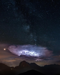 I was just trying to capture the milky way but witnessed this spectacular storm as well over Langkofel in The Dolomites
