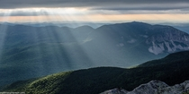 I was lucky enough to capture sunbeams breaking through cloud cover onto Franconia Notch in New Hampshire