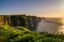 I went on a trip to Ireland last year I took this photo at the Cliffs of Moher at sunset It was stormy af that day but the view was great