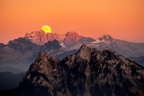I went out to capture the sunset but then looked towards the other side and saw this incredible moonrise happening simultaneously Mount Gnipen Switzerland
