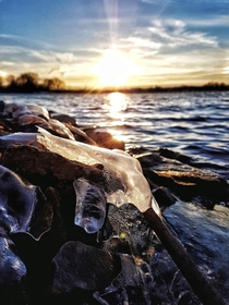 Ice chunks on the banks of the Rideau River Ontario Canada catching the light from the sunset  OC
