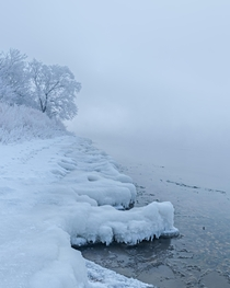 Ice frost and fog along the edge of a lake in south Saskatchewan