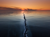 Ice on Lake Baikal is a very interesting phenomenon Ice ridges cracks tears hugging All this creates unique and fantastic stories A simple yet otherworldly shot of Lake Baikal Russia  Photo by Alexey Trofimov