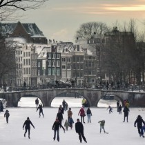 Ice skating highway Keizersgracht canal Amsterdam