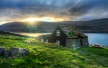 Icelandic hut with grass roof at sunrise