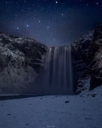 Icelands very popular Skogafoss waterfall in the middle of the night