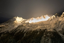 Illumination of a peak Aiguille de la Tsa in the Swiss Alps