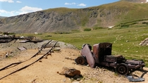 Im always curios as to how these old abandoned vehicles made it into the mountains Top of Butler Gulch Trail Colorado USA Pile of rust is was a  Plymouth