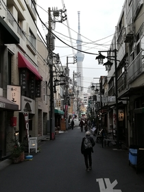 Im jumping on the Tokyo train today Here a shot of a side street in Asakusa with the Skytree in the background