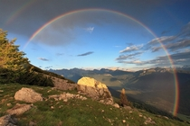 Impressive rainbow over the Dolemites of Italy