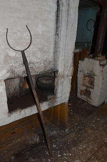 In an abandoned Russian peasant house in the village Russian stove and grasp