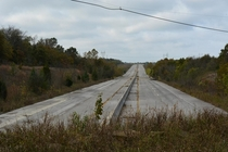 In  Interstate  in Oklahoma was realigned to join up with the new Creek Turnpike east of Tulsa As a result almost two miles of the original four-lane Will Rogers Turnpike was deserted but remains visible today