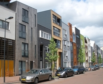 In the Amsterdam suburb IJburg narrow individual parcels are sold and the residents then design their own house with some interesting results