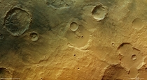 In the ancient cratered southern highlands of Mars the faint traces of a wet past are seen in the form of channels fluidised debris around craters and blocks of eroded sediments