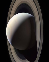 In the cold dark reaches of our Solar System a billion miles from the sun lies Saturn