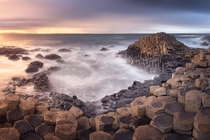 In the Wake Of Poseidon Panorama of Giant Causeway in the Evening Northern Ireland United Kingdom  by ansharphoto