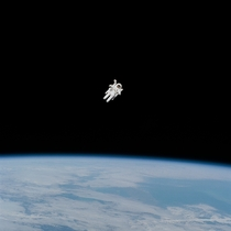 In this Feb   photograph of the first untethered spacewalk NASA astronaut Bruce McCandless is in the midst of the first field tryout of a nitrogen-propelled backpack device called the Manned Maneuvering Unit MMU