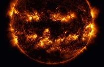 In this photo released by NASA combined active regions of the sun resemble a jack-o-lanterns face