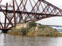 Inchgarvie island beneath the iconic Forth rail bridge Scotland Fort on the island dates back to early s