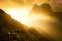 Incredible golden light while hiking New Zealands MacKinnon Pass