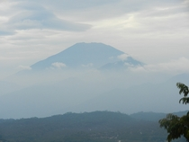 Indonesian volcano emerging from the clouds  x
