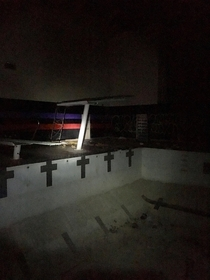 indoor pool at an abandoned college gym