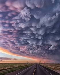 Insane mammatus clouds at sunset with some of the best colours Ive ever seen  Texas