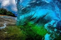 Inside a wave breaking on the shore in Kauai