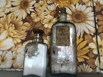 Inside an abandoned mansion I explored a few months ago Love these old-fashioned bottles This property is full of belongings spanning decades Link in comments for more