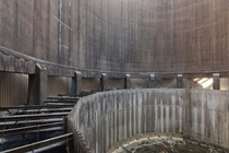 Inside an abandoned power plants cooling tower  by Sbastien Ernest