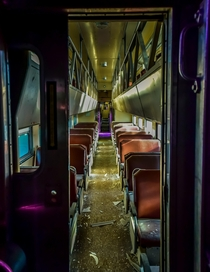 Inside an abandoned train car The purple lighting was due to spray paint and paper over the windows