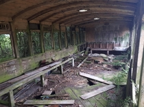 Inside of abandoned XIX century passenger car converted to waiting room